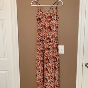 A super cute maxi dress with a fun back and slits!